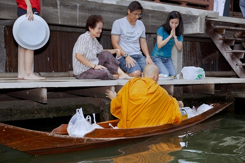 buddhist monk morning alms in Bangkok's floating markets